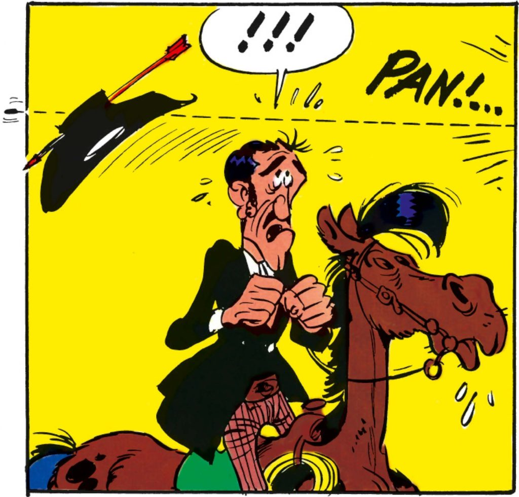 Cowboy riding a horse, his hat is shot off by an arrow